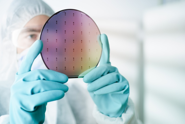 Scientist examining silicon wafer